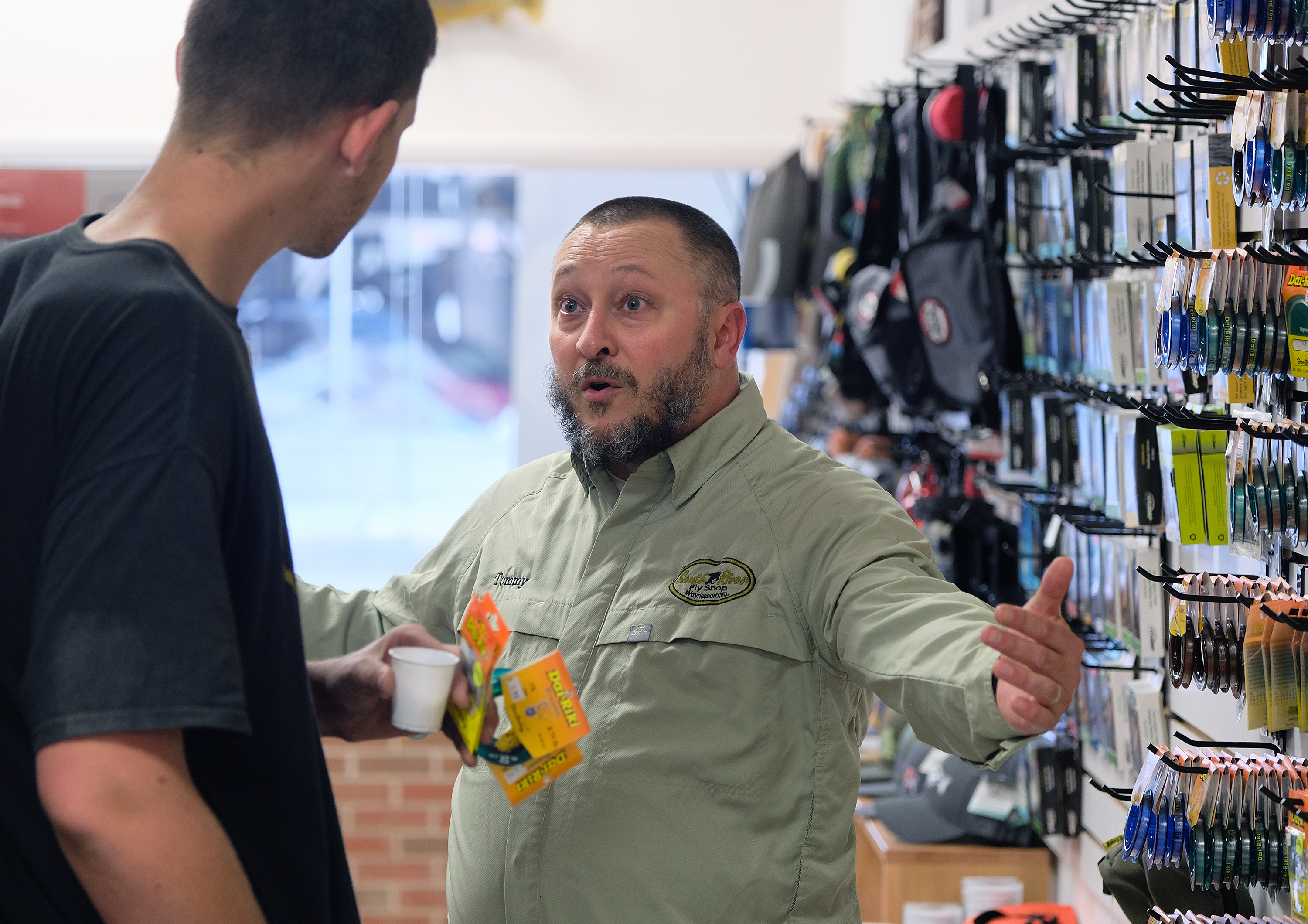 Tommy Lawhorne, right, talks with customer Chase Halterman of Goshen, Va. at the South River Fly shop in Waynesboro, Va., Thursday, Oct. 13, 2016. (Photo by Norm Shafer).