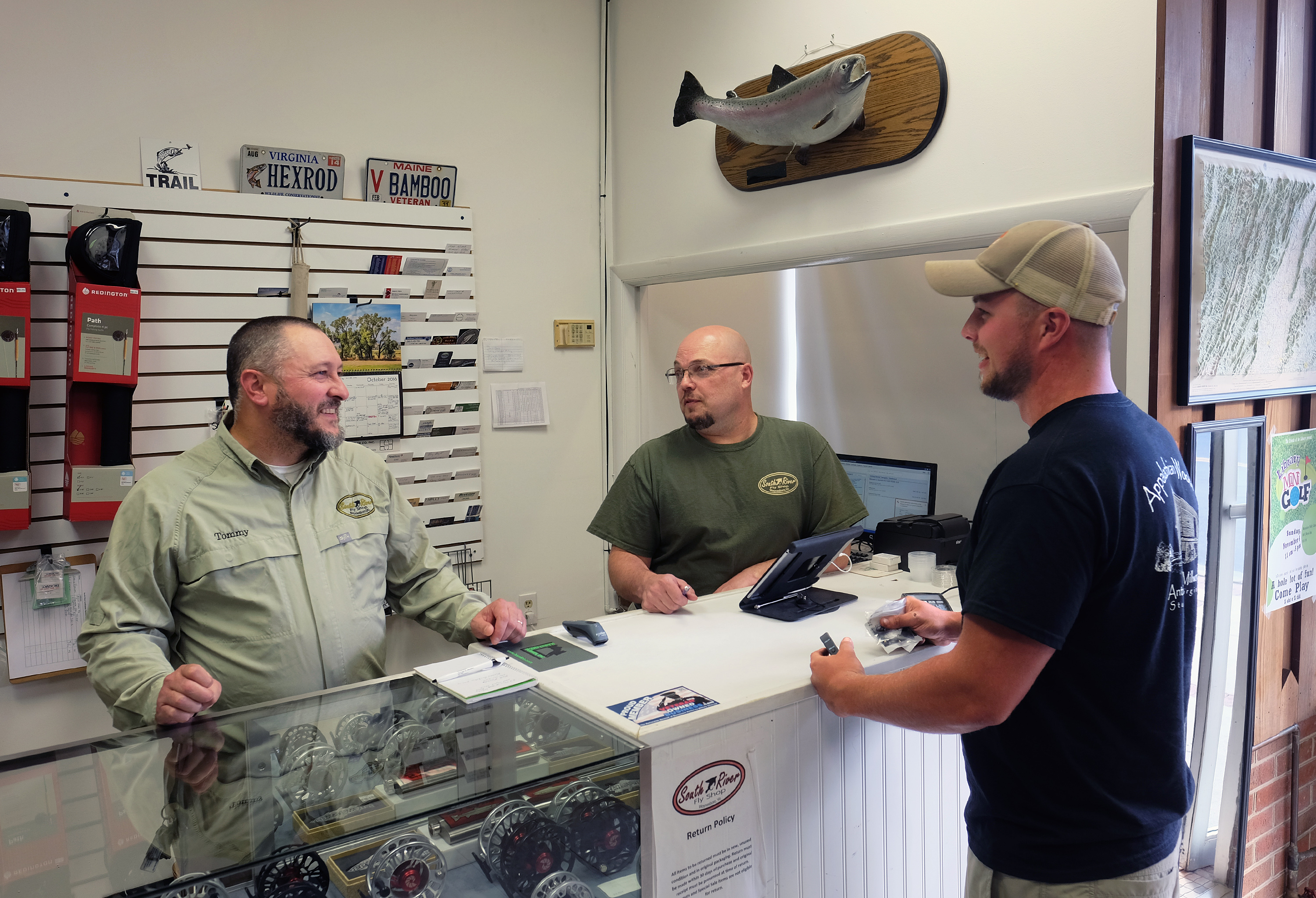 Tommy Lawhorne, and Kevin Little talk with customer Will Walter of Doom, Va. at the South River Fly shop in Waynesboro, Va., Thursday, Oct. 13, 2016. (Photo by Norm Shafer).