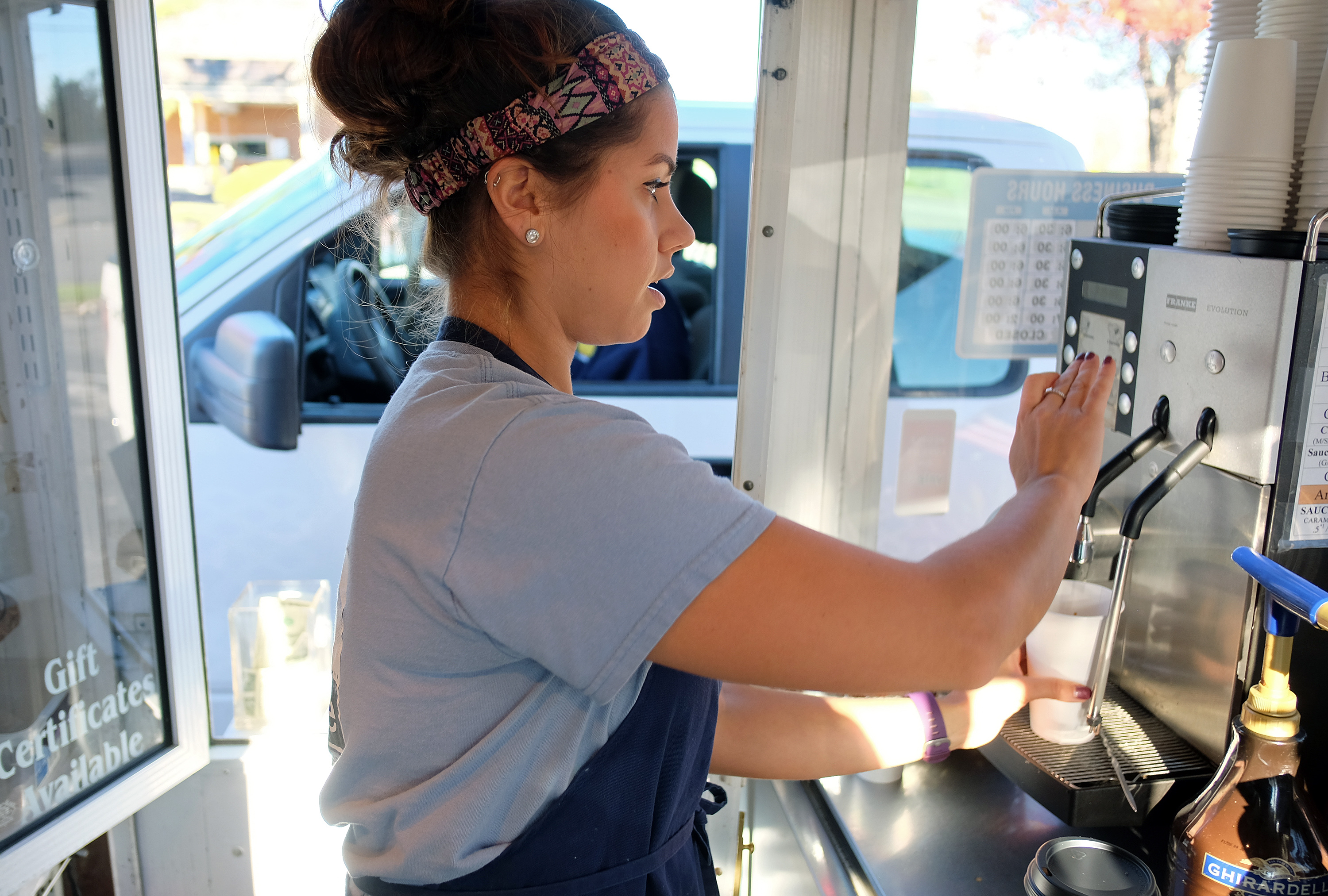 Kelsey Shreckhise, manager of Micah's Coffee helps a customer in Waynesboro, Va. Thursday Nov. 10, 2016. (Photo by Norm Shafer).