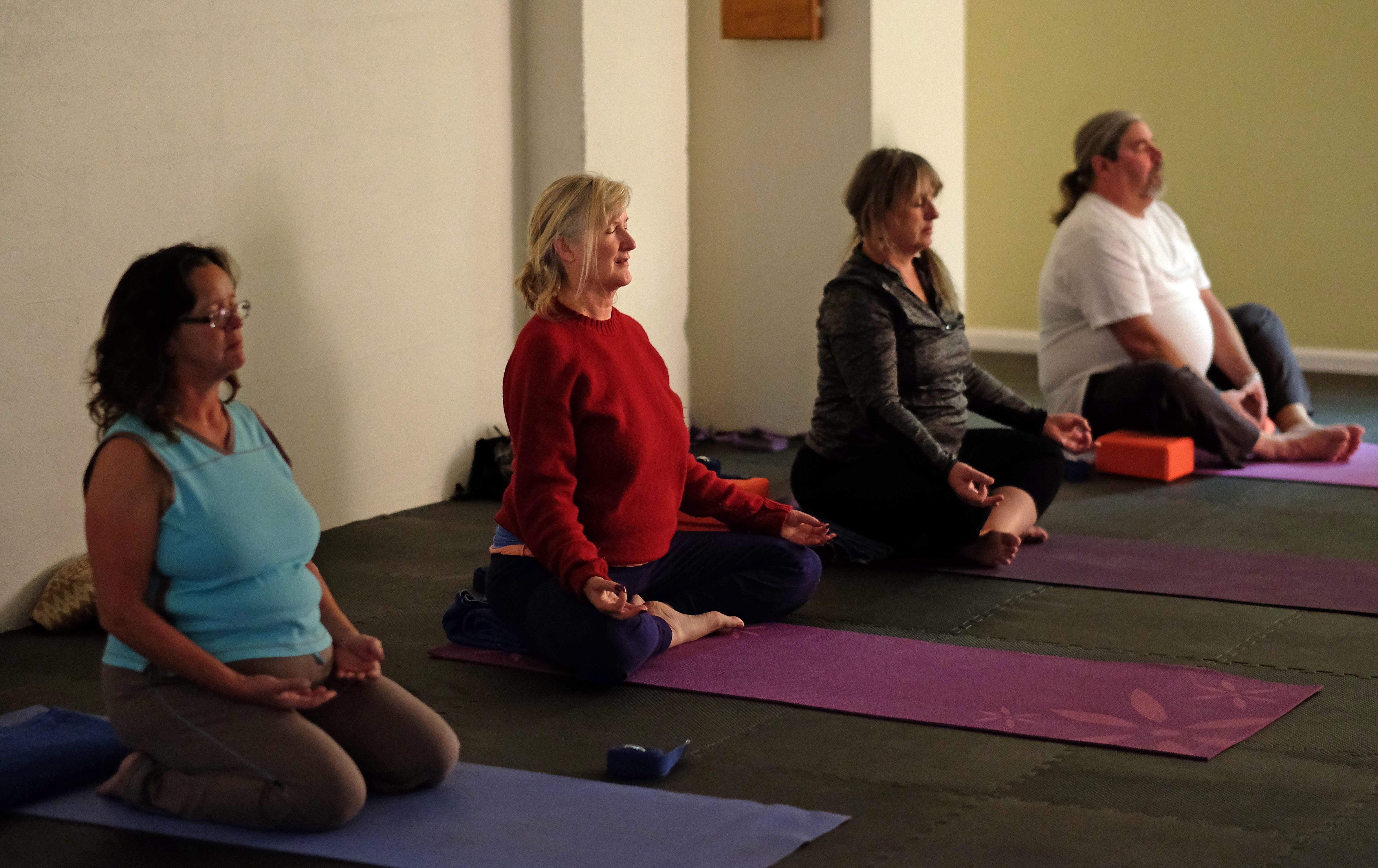A community yoga class at Birdseed Yoga, Waynesboro, Va. Wednesday Nov. 23, 2016. (Photo by Norm Shafer).
