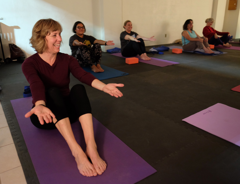 Paula Figgatt teaches a community yoga class at Birdseed Yoga, Waynesboro, Va. Wednesday Nov. 23, 2016. (Photo by Norm Shafer).