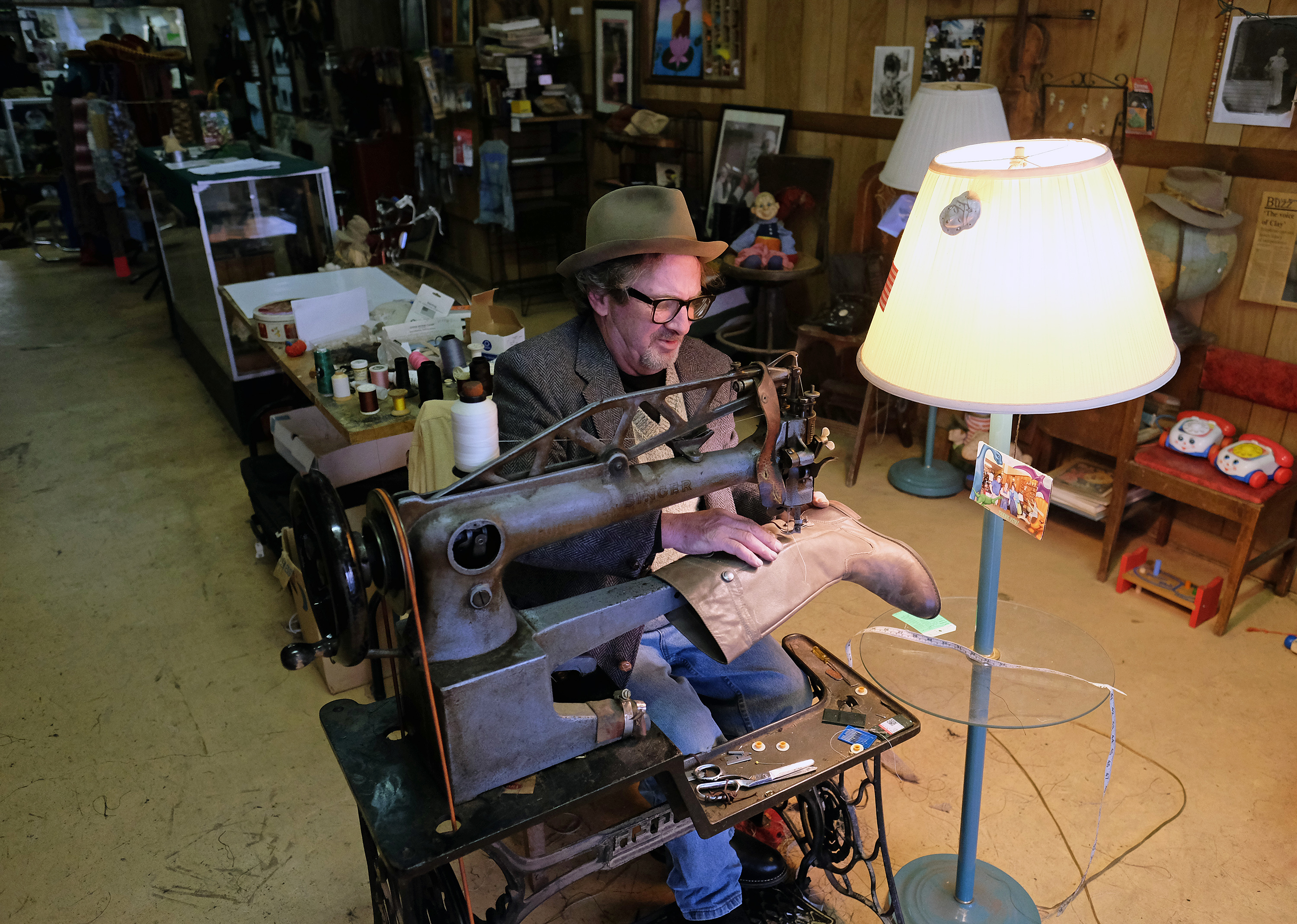 David Young sews a boot on an old Singer treadle sewing machine,Wednesday Nov. 23, 2016. (Photo by Norm Shafer).